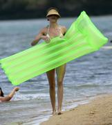 Cameron Diaz & Drew Barrymore in bikini on beach & in the sea in Hawaii, Feb 24 2007